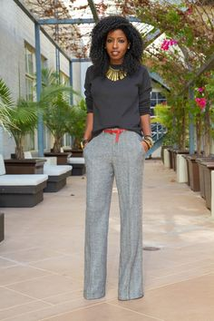 Crew neck sweatshirt with wide leg, herringbone trousers. Perfect pop of red and gold accessories.