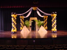 FMU McNair Auditorium Pageant Decor.  Center balloon is an exploding 3 ft balloon which released 150 smaller balloons at winner announcement.