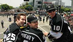 Kings from left, Dustin Penner, Drew Doughty and Mike Richards ride the victory bus in front of Staples Center. Mike Richards, La Kings Hockey, Hockey Teams, Ice Hockey, Victory Parade, King Baby, Los Angeles Kings, Win Or Lose, Rally