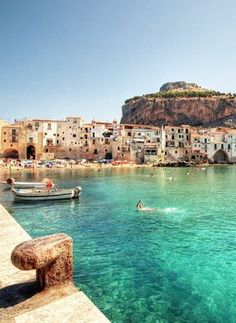 Buon Ferragosto / Happy August Holiday! The day when nearly everyone in Italy heads to the beach. This is one of my favourite beaches I've ever seen, Cefalu in North Sicily.