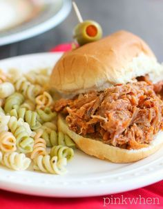 Easy and Delicious 3 Ingredient Crock Pot Pulled Pork recipe.