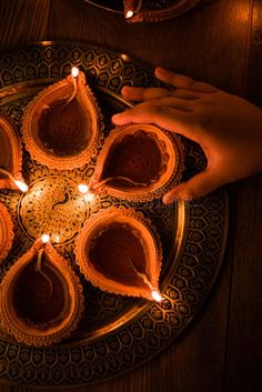 Happy Diwali - Hand Holding Or Lighting Or Arranging Diwali Diya Or Clay Lamp In Brass Plate, Selective Focus Stock Photo - Image of diwali, celebrate: 101029804 Diwali Festival Of Lights, Diwali Lights, Diwali Lamps, Happy Diwali Wallpapers, Happy Diwali Images, Diwali Photography, Diwali Pictures, Diwali Decorations At Home, Housewarming Decorations