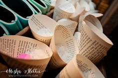 Wedding exit toss flower petals wrapped in book pages.