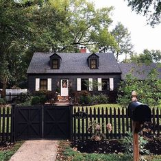 I secretly dream of having a dark/black exterior home and absolutely nails it. Total charm and. Black House Exterior, House Paint Exterior, Exterior Paint Colors, Exterior House Colors, Exterior Design, Exterior Homes, Farmhouse Exterior Colors, Craftsman Exterior, Craftsman Style
