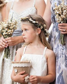 This ethereal flower girl tossed dried flowers down the aisle and sported a head wreath made by the bride's sister
