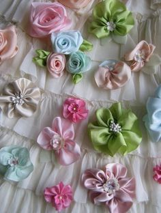 Ribbon Flowers! beautiful flowers made out of your favorite ribbon. I'm making these asap.
