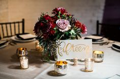 Amnesia roses, burgundy dahlias, navy blue privet berries and eucalyptus wedding reception centerpiece in mercury glass compote at Via Veccia Winery in Columbus, Ohio