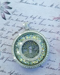 Legacy locket with stardust crystals, a window frame and the new silver plate. Love this! carri.origamiowl.com