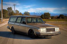 Volvo 240 in gold. Lowered by some maniac.