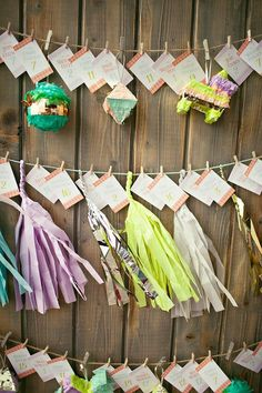 Pin for Later: 50 Creative Escort Card Ideas That Double as Decor Colorful Tassels Photo by Amelia Lyon via 100 Layer Cake