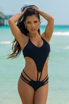 meg liz one piece monokini. The sporty look of the top keeps you covered up and comfortable, while the edgy cut outs and strappy bottom keep things interesting! A skimpy backside completes this look. This designer swimwear option looks great if you are lounging on the beach, partying poolside, or playing an intense game of beach volleyball. #monokini