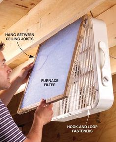 Air cleaner on the cheap: attach a furnace filter with hook-and-loop tabs to the air intake side of a box fan. Fine dust particles from sanding and sawing will be drawn into the filter by the vacuum created by the fan.