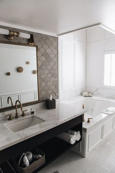 The Landsby, marble vanity top, fish scale tiles, deco lights