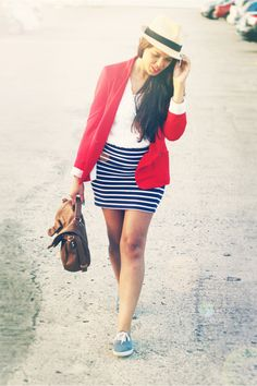 Red blazer, striped skirt, and sneaks.