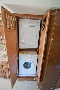 Easy access to washer and dryer aboard the #Newmar Essex #RV