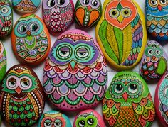 Beach stone with hand-painted designs in acrylics    These stones are unique with their design. I paint and draw all of my original designs by hand with the acrylic paints, small brushes or paint pens with extra fine tip. I use also isographs (0,2 / 0,3) with different inks. No stencils are used. All designs are created with my imagination. They are protected with 2 or 3 layers of high quality acrylic varnish coat and are signed & numbered .  The pebbles are water resistant, to clean...