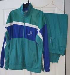 """Rare Vintage Sergio Tacchini warm up track suit. Excellent Condition. This warm up is made with a soft velour fabric with soft leather accents on shoulders and sleeves. This piece is in amazing condition with no tears, stains or smells of any kind. The jacket is a men's 46 and the pants are a men's 40, which are European sizes.   Jacket measurements are as follows:   Chest measures from underarm seam to underarm seam 27 1/2""""  Length 29 1/2""""   Sleeve from collar to ..."""