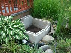 Add-on bog filter for my pond. Basic form achieved using cement blocks.