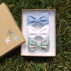 Blue chambray, white denim, and pale blue floral hair bows from Seaside Sparrow.  Seaside Sparrow bows make the perfect birthday gift. on Etsy, $11.00