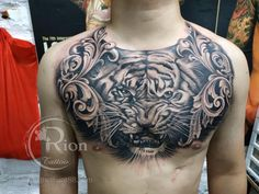 Check which tattoo suits you best. Traditional Tiger Tattoo, Chest Tattoo, Sleeve Tattoos, Polynesian Tattoos, Top, Tattoo, Rosary Tattoos, Wristlets, Tattoo Sleeves