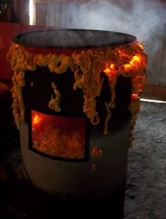 """toxic waste barrels, a """"window"""" cut out shows a skull surrounded by """"toxic goo"""" lights and smoke machine/ dry ice increase the effect!"""