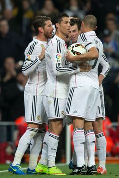 Cristiano Ronaldo of Real Madrid CF celebrates scoring their second goal with teammates Gareth Bale Karim Benzema and Sergio Ramos during tha La Liga match between Real Madrid CF and Levante UD at Estadio Santiago Bernabeu on March 15, 2015 in Madrid, Spain.