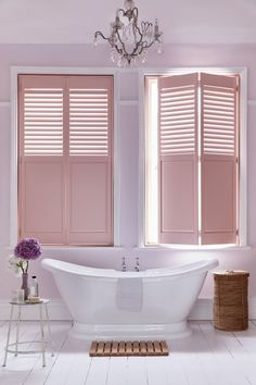 Shutters are fast becoming a great alternative to blinds and curtains and they work particularly well in bathrooms as they offer privacy as well as light when needed. Keep the rest of the scheme plain so the shutters become the highlight. Team with rustic accessories to add texture.   Full height shutters with mid rail in pink, from £168 a sq metre, (a colour matching service is available), The Shutter Store