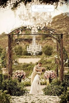 floral chandelier but with white romantic draping from poles of archway