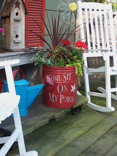 Sit a spell - love this old bucket made into a planter.