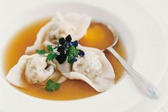 Scallop consomme with prawn dumplings