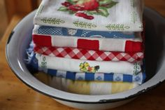Vintage tablecloths nestled in an old dishpan