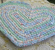 Heart rug made from old bed sheet strips.