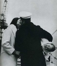 "1940s, after 14 months at sea on Her Majesty's frigate Whitby, seaman Anthony Bennett meets his baby for the first time. and holds him like a football so he can make out with his wife. ""gee dad nice to meet you too"""