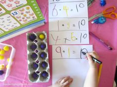 Combinations of 10 using an egg carton and pompoms.