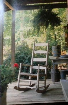 Rocking chair on rustic cabin front porch