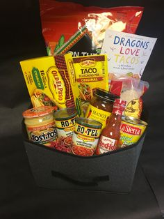 "waffles holder Taco Night Gift Basket To promote our Literacy Night at school, I created themed gift baskets to raffle off. Each basket included a book that matched the theme of the basket. Book included was ""Dragons Live Tacos. Theme Baskets, Themed Gift Baskets, Birthday Gift Baskets, Diy Gift Baskets, Birthday Gifts, Basket Gift, Raffle Gift Basket Ideas, Wine Baskets, Christmas Baskets"