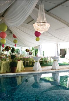Chandelier in a tent? YES! Over a pool? YES!!  www.apresparty.com