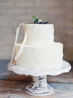 Winter white wedding cake   Kate Weinstein Photo   see more on: http://burnettsboards.com/2014/09/timeless-elegant-snowy-winter-wedding/