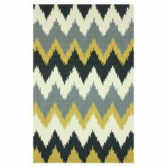 Hand-tufted rug with a chevron motif.   Product: RugConstruction Material: 100% PolyesterColor: MultiFeatures: Hand-tufted Note: Please be aware that actual colors may vary from those shown on your screen. Accent rugs may also not show the entire pattern that the corresponding area rugs have.Cleaning and Care: These rugs can be spot treated with a mild detergent and water. Professional cleaning is recommended if necessary.