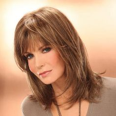 Kris Wig by Jaclyn Smith is a sleek, straight wig with long, feathered layers for an on-trend look.