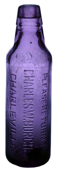 Please return to CHARLES W. BURCHER Charleville. Smooth base. Dark sun-coloured amethyst. Lamont type Soda Water bottle. c1910s (Hammer price $185, Auction 5, Lot 76, August 2011). Apothecary Bottles, Antique Bottles, Vintage Bottles, Bottles And Jars, Antique Glass, Drink Bottles, Perfume Bottles, Old Medicine Bottles, Small Glass Bottles