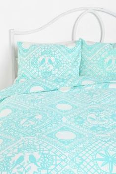 With coral sheets and fun pillows
