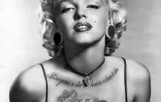 marilyn monroe with tattoos and guns