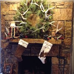 .natural green pine wreath with antlers....a very campy look!