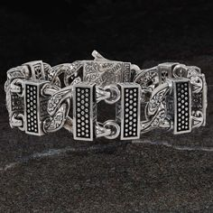 Tribal Hollywood's men's chunky bracelets are forged from hefty sterling silver with big wide links, large I. tags and weighty semi-precious stones. Sterling Silver Cross, Sterling Silver Bracelets, Bracelets For Men, Link Bracelets, Jewelry Drawing, Skull Bracelet, Circle Pattern, Silver Bars, Floral Patterns