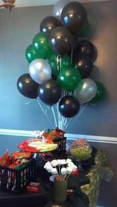 Use black and green balloons for your Army-themed birthday party. Camouflage Birthday Party, Army Themed Birthday, Army Birthday Parties, Army's Birthday, Camo Party, Hunting Birthday, Nerf Party, Birthday Party Themes, Birthday Ideas