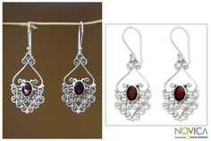 From Indonesia's Wayan Asmana, these enchanting earrings evoke heirloom lace. An oval garnet sparkles in the center of these sterling silver filigree earrings.