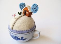 tiny world winter cottage w/ snowman by Mimi Kirchner. Mimi sells this as a pdf pattern too; in fact, she's just revised and improved it.