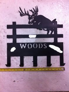 BUCK JUMPING the FENCE coat rack, it is about 17 inches wide and can be customized with your last name cut out for $70($60 with no name)