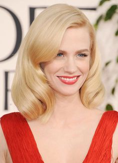 """Solid platinum shades that are reminiscent of Marylin Monroe are back and hotter than ever. Check out on this classic color and style on January Jones of """"Mad Men"""" Photo from: http://www.harpersbazaar.com/beauty/hair-articles/blonde-hair#slide-1"""